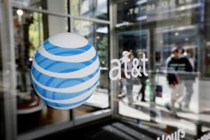 In this Wednesday, Oct. 17, 2012, file photo, an AT&T logo is displayed on an AT&T Wireless retail store front, in Philadelphia.