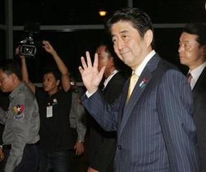 Japanese Prime Minister Shinzo Abe waves on his arrival at Yangon airport in Myanmar, May 24, 2013.