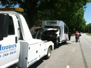 A hotel shuttle bus is readied for towing after the crash in Atlanta.