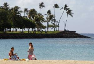 Two women chat after arriving at Ala Moana Beach, near the Hawaii Convention Center in Honolulu, Tuesday, Nov. 8, 2011, where preparations continued for the APEC Summit.
