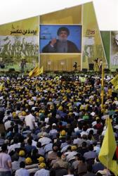 Hezbollah leader Sheik Hassan Nasrallah speaks during a rally commemorating Liberation Day, which marks the withdrawal of the Israeli army from Lebanon in 2000, Lebanon, Saturday May 25, 2013.