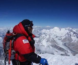 Yuichiro Miura, right, who has had four heart operations in recent years, stands atop the summit of Mount Everest, Thursday, May 23, 2013.