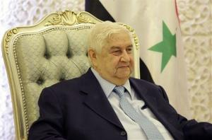 Syrian Foreign Minister Walid al-Moallem meets with his Iraqi counterpart in Baghdad, Iraq, Sunday, May 26, 2013.