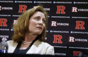Julie Hermann listens as Rutgers President Robert Barchi announces Hermann as athletic director, Wednesday, May 15, 2013, in Piscataway, NJ.