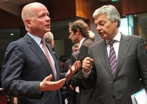 British Foreign Secretary William Hague, left, talks with Belgium's Foreign Minister Didier Reynders, during the EU foreign ministers meeting, at the European Council building in Brussels, Monday, May 27, 2013. The European Union nations remain divided on Monday whether to ease sanctions against Syria to allow for weapons shipments to...