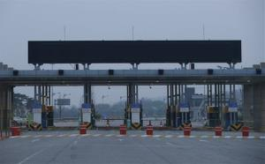 Empty gates for North Korea's Kaesong city are seen at the customs, immigration, and quarantine office near the border village of Panmunjom in Paju, north of Seoul, South Korea, Friday, May 3, 2013.