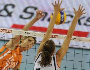 Belgium's Els Vandesteene, right, tries to block a shot by the Netherlands' Ingrid Louise Visser during their Women's European Volleyball Championships playoff match in Lodz, Poland, Sept. 30, 2009.