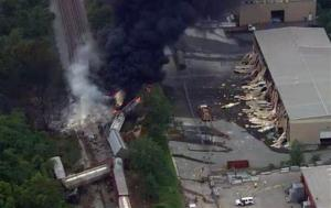 This image provided by WBAL-TV shows a train derailment outside Baltimore on Tuesday.