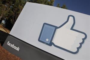 The Facebook logo is displayed outside of Facebook's new headquarters in Menlo Park, California.