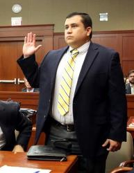 Defendant George Zimmerman, accused in the killing of Trayvon Martin, is sworn in for testimony in Seminole circuit court, in Sanford, Fla.,  during a pre-trial hearing, Tuesday, April 30, 2013.