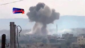 This May 29 image shows an explosion from shelling in Rastan, Syria.