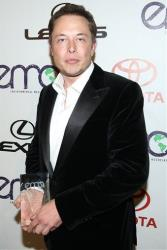 Elon Musk holds the EMA Corporate Responsibility Award backstage at the 22nd Annual Environmental Media Awards on Saturday Sept. 29, 2012, at Warner Bros. Studios in Burbank, Calif.