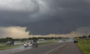 A wall cloud forms near Interstate 35 and Purcell, Okla. on Thursday, May 30, 2013.
