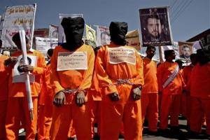 Protesters tion demanding the release of Yemeni detainees in Guantanamo Bay in front of the U.S. embassy in Sanaa, Yemen, on April 16, 2013.