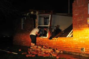People retrieve belongings from a home destroyed after severe weather passed through in Union City, Okla.