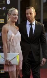 In this Nov. 4,  2012 photo, Oscar Pistorius and Reeva Steenkamp are seen at an awards ceremony, in Johannesburg, South Africa. He was charged with her murder in February.