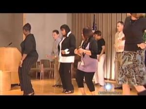 IRS employees learn the Cupid Shuffle line dance.