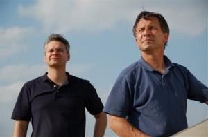 This undated photo provided by The Discovery Channel shows Carl Young and Tim Samaras watching the sky.