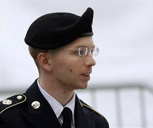 Army Pfc. Bradley Manning is escorted into a courthouse in Fort Meade, Md., Tuesday, May 21, 2013, before a pretrial military hearing.