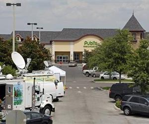 In this Sunday, May 19, 2013 file photo, satellite trucks are parked outside a supermarket where the highest Powerball jackpot worth an estimated $590.5 million was sold in Zephyrhills, Fla.