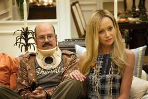 This undated publicity photo released by Netflix shows David Cross, left, and Portia de Rossi in a scene from the new season of Arrested Development.