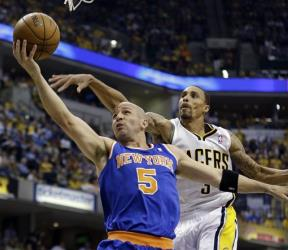 Jason Kidd shoots past Indiana Pacers' George Hill during the first half of Game 4 of an Eastern Conference semifinal NBA basketball playoff series.
