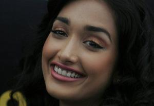 In this Dec. 19, 2008 file photo, Bollywood actress Jiah Khan smiles during a promotional event for the Hindi movie 'Ghajini' in Bangalore, India.