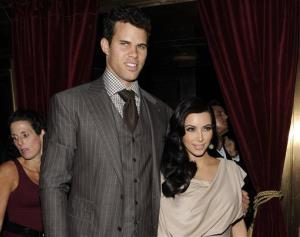 This Aug. 31, 2011 file photo shows newlyweds Kim Kardashian and Kris Humphries attending a party thrown in their honor at Capitale in New York.