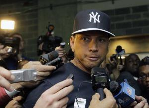 New York Yankees' Alex Rodriguez talks to reporters outside the Yankees' clubhouse in New York.
