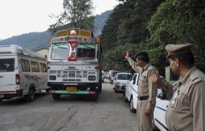 Indian police check vehicles after an American woman was raped Tuesday in the northern Indian resort town of Manali.