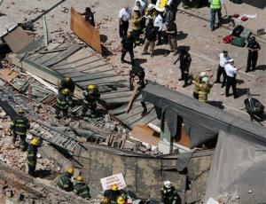 Rescue personnel search the scene of a building collapse on the edge of downtown Philadelphia Wednesday.