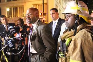 Philadelphia Mayor Michael Nutter, center, and Fire Commissioner Lloyd Ayers, right, announce that the death toll from the collapsed building is now up to 6 people.