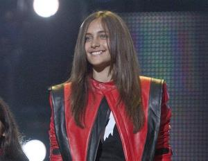 In this Oct. 8, 2011 file photo Paris Jackson smiles on stage at the Michael Forever the Tribute Concert, at the Millennium Stadium in Cardiff, Wales.