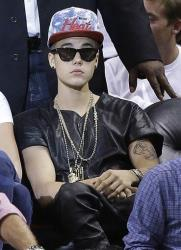 Justin Bieber watches Game 7 in the NBA basketball Eastern Conference finals playoff series between the Miami Heat and the Indiana Pacers, Monday, June 3, 2013 in Miami.