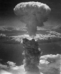 A column of dark smoke rises over Nagasaki in this Aug. 9, 1945, file photo.