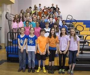 This June 6, 2013 photo shows 24 sets of twins who are fifth-graders at Highcrest Middle School in Wilmette, Ill.  The school is trying to break a Guinness World Record for number of twins in a grade.
