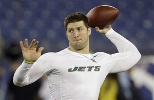 In this Dec. 17, 2012 photo, then-New York Jets quarterback Tim Tebow warms up before an NFL football game in Nashville, Tenn.