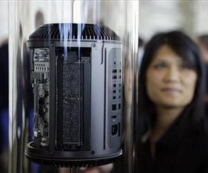 The new Mac Pro is previewed at the Apple Worldwide Developers Conference Monday, June 10, 2013 in San Francisco.