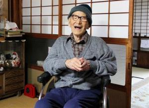 Jiroemon Kimura smiles after he was presented with the certificate of the world's oldest living man from Guinness last year.