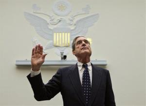 FBI Director Robert Mueller is sworn in on on Capitol Hill Thursday.