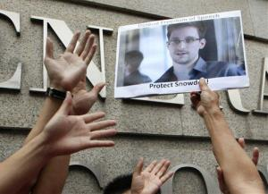 A supporter holds a picture of Edward Snowden outside the U.S. Consulate General in Hong Kong Thursday.