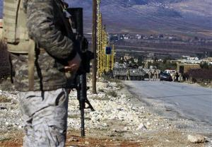 A solider at a checkpoint near the Syria-Lebanon border.