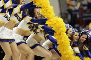 UC Santa Barbara cheerleaders perform during the an NCAA college basketball game.