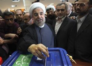 Iranian presidential candidate Hasan Rowhani casts his ballot during presidential elections at a polling station in downtown Tehran, Iran, Friday, June 14, 2013.