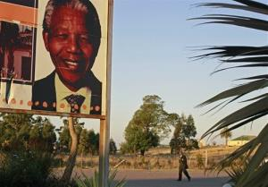 A billboard with a poster of  former South African President Nelson Mandela, at the Nelson Mandela museum near his home,  in Qunu, South Africa, Wednesday,  June 12, 2013.  Former President Nelson Mandela began responding better to treatment Wednesday morning for a recurring lung infection following a difficult last few days,...