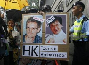 A supporter holds picture of Edward Snowden during a protest outside the Consulate General of the United States in Hong Kong.