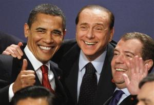 President Barack Obama, Italian Prime Minister Silvio Berlusconi, center, and Russian President Dmitry Medvedev, right, smile during a group photo at the G20 Summit in London.