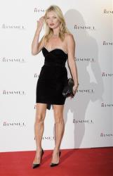 British model Kate Moss arrives for the Rimmel party at a central London venue, Thursday, Sept. 15, 2011.