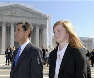 Abigail Fisher, the Texan involved in the University of Texas affirmative action case, and Edward Blum, who runs a group opposed to affirmative action, walk outside the Supreme Court, Oct. 10, 2012.