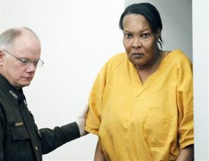 Morris Garner, who also goes by the name Tracey Lynn Garner, is escorted into a Hinds County courtroom by bailiff Tony Queen in Jackson, Miss., Tuesday, Sept. 11, 2012, for a bond hearing.